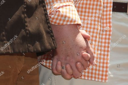 Stock Picture of Kate Burns, Sheila Schroeder Plaintiffs in a lawsuit to overturn Colorado's gay marriage ban, Kate Burns, left, holds the hand of her partner, Sheila Schroeder, during a noon hour news conference outside the federal courthouse in downtown Denver on . Six gay couples filed the lawsuit to ask for an injunction to stop all officials from enforcing the ban on gay marriage in Colorado