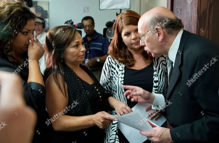 "Kenneth Feinberg, Monica Coronado, Rosie Cortinas, Laura Christian Kenneth Feinberg, the independent claims administrator for the GM Ignition Compensation Program, right, meets with, from left, Monica Coronado, and Rosie Cortinas, of Homedale, Idaho, sister and mother of Amador Cortinas, and Laura Christian birth mother of Amber Marie Rose, from Harwood, Md., after a news conference at the National Press Club, in Washington, where he announced the details of the program, including eligibility, scope, rules for the program, and timing of submitting claims, during a news conference . Amador Cortinas, was 23 years old, when he died of a vehicular accident allegedly involving a ""defective GM vehicle,"" Rosie Cortinas claimed"