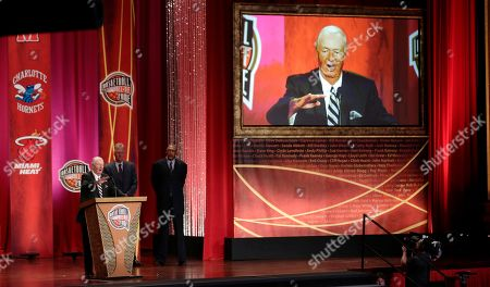 """Bob Leonard, Larry Bird, Mel Daniels Former ABA head coach Bob """"Slick"""" Leonard addresses a gathering during his enshrinement ceremony for the Basketball Hall of Fame in Springfield, Mass., . Leonard, who has the record for winningest coach in the ABA, led the Indiana Pacers to three ABA Championships in 1970, 1972 and 1973. At rear are Hall of Famers Larry Bird and Mel Daniels"""
