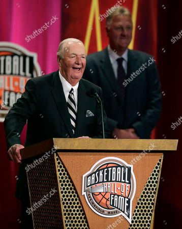 """Bob Leonard, Larry Bird Former ABA head coach Bob """"Slick"""" Leonard smiles as he addresses a gathering during his enshrinement ceremony for the Basketball Hall of Fame in Springfield, Mass., . Leonard, who has the record for winningest coach in the ABA, led the Indiana Pacers to three ABA Championships in 1970, 1972 and 1973. At rear right is Hall of Famer Larry Bird"""