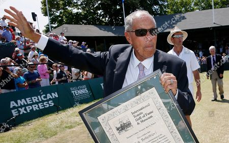 Nick Bollettieri Nick Bollettieri holds his plaque as he waves to the crowd after his induction into the International Tennis Hall of Fame in Newport, R.I