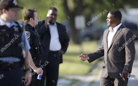 Eric J. Kellogg Harvey Mayor Eric J. Kellogg, right, talks with police officers during a hostage standoff in the southern Chicago suburb of Harvey, Ill. A published report says the mayor of the financially struggling Harvey, directed a federal grant be used to buy a $51,000 SUV for his own use while the money was intended to buy two new police cars for Harvey, where officials said they didn't have enough cruisers to patrol the streets