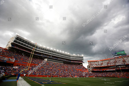 Dark clouds move over Ben Hill Griifin Stadium at Florida Field during a weather delay before the start of an NCAA college football game between Florida and Idaho in Gainesville, Fla