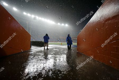 Rain pours down on the field at Ben Hill Griffin stadium as a weather delay continues to hold up the start of an NCAA college football game between Florida and Idaho in Gainesville, Fla