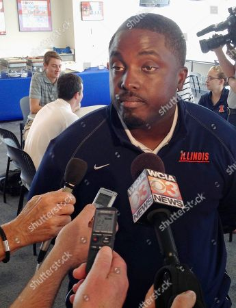 Stock Picture of Tim Banks Illinois defensive coordinator Tim Banks talks to reporters at Memorial Stadium in Champaign, Ill., on . Banks believes the Illini defense will be significantly better this fall after being among the Big Ten's worst in 2013