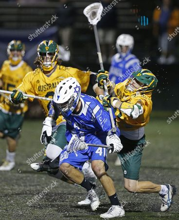 Noah Miller, Keith Nyberg Australia defenseman Keith Nyberg, right, bodychecks Israel's Noah Miller as Miller advances the ball downfield in a semi-final game against in the Lacrosse World Championships, in Commerce City, Colo., . Australia won 9-8
