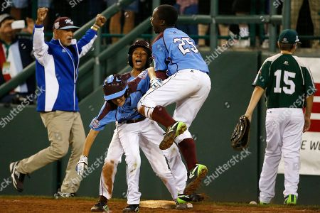 Mo'ne Davis, Tai Shanahan, Zion Spearman Philadelphia's Tai Shanahan, left center, celebrates his walk-off single with teammate Mo'ne Davis, center rear, and Zion Spearman (25) during the sixth inning of a baseball game against Pearland in United States pool play at the Little League World Series tournament in South Williamsport, Pa., . Philadelphia won 7-6