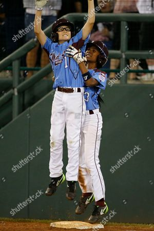 Mo'ne Davis, Tai Shanahan Philadelphia's Tai Shanahan (7) celebrates his walk-off single with teammate Mo'ne Davis (3) during the sixth inning of a baseball game against Pearland in United States pool play at the Little League World Series tournament in South Williamsport, Pa., . Philadelphia won 7-6