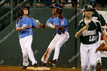 Mo'ne Davis, Tai Shanahan Philadelphia's Tai Shanahan (7) celebrates his walk-off single with teammate Mo'ne Davis, center, as Pearland pitcher Landon Donley (12) runs off the field during the sixth inning of a baseball game against Pearland in United States pool play at the Little League World Series tournament in South Williamsport, Pa., . Philadelphia won 7-6