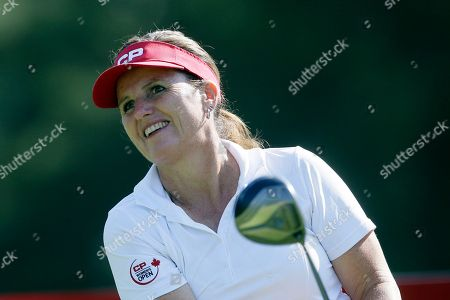 Stock Image of Lorie Kane Lorie Kane drives on the 11th hole during the first round of the Meijer LPGA Classic golf tournament at Blythefield Country Club, in Belmont, Mich