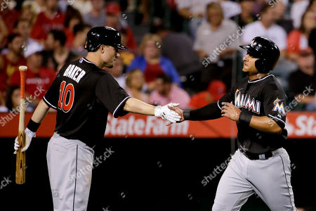 Donovan Solano, Jeff Baker Miami Marlins' Donovan Solano, right, is greeted by Jeff Baker after scoring on a hit by Christian Yelich during the third inning of a baseball game against the Los Angeles Angels in Anaheim, Calif