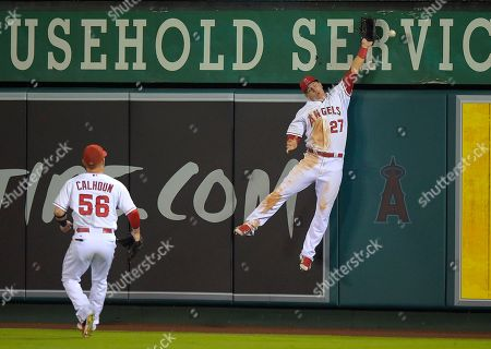 Mike Trout, Kole Calhoun Los Angeles Angels center fielder Mike Trout, right, can't reach a ball hit for a triple by Miami Marlins' Jeff Baker, as right fielder Kole Calhoun watches during the eighth inning of a baseball game, in Anaheim, Calif
