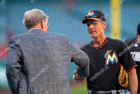 Bud Selig, Brett Butler Outgoing baseball commissioner Bud Selig, left, greets Miami Marlins third base coach Brett Butler prior to the Marlins' baseball game against the Los Angeles Angels, in Anaheim, Calif