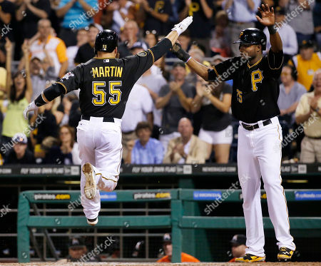 Russell Martin, Gregory Polanco Pittsburgh Pirates' Russell Martin (55) celebrates with Gregory Polanco (25) after they both scored on a double by Pirates' Gaby Sanchez off Miami Marlins relief pitcher Mike Dunn during the seventh inning of a baseball game in Pittsburgh