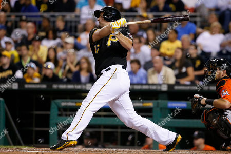 Gaby Sanchez Pittsburgh Pirates' Gaby Sanchez drives in two runs with a double off Miami Marlins relief pitcher Mike Dunn during the seventh inning of a baseball game in Pittsburgh . The Pirates won 7-3