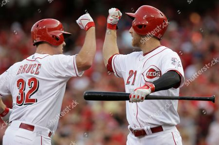Jay Bruce, Todd Frazier Cincinnati Reds' Jay Bruce (32) is congratulated by Todd Frazier (21) after Bruce hit a solo home run off Miami Marlins pitcher Brad Penny in the first inning of a baseball game, in Cincinnati