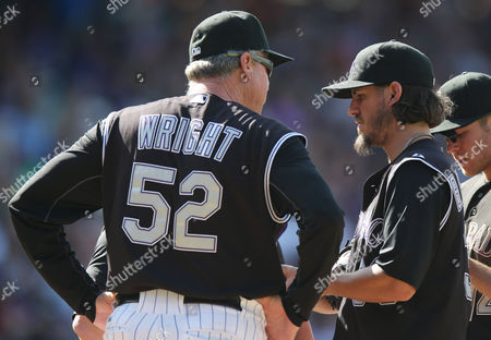 Jim Wright, Christian Bergman Colorado Rockies pitching coach Jim Wright, left, confers with starting pitcher Christian Bergman after he gave up an RBI-double to Miami Marlins' Jeff Baker in the seventh inning of the Rockies' 7-4 victory in a baseball game in Denver on