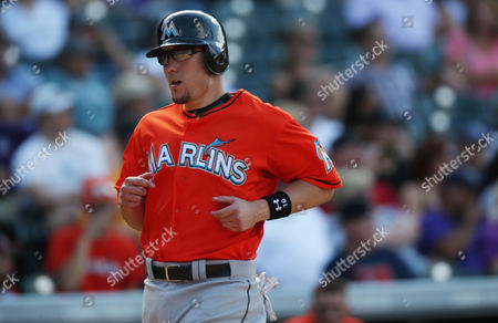 Jeff Baker Miami Marlins' Jeff Baker scores on a single by Giancarlo Stanton against the Colorado Rockies in the seventh inning of the Rockies' 7-4 victory in a baseball game in Denver on