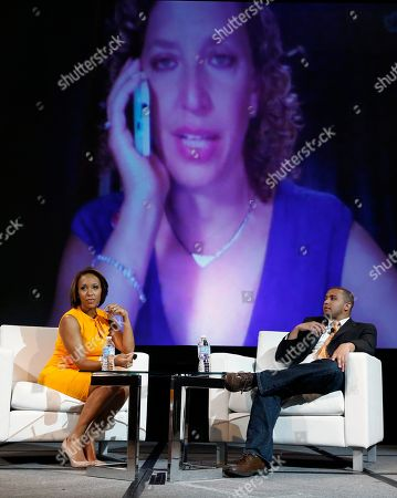 Debbie Wasserman Schultz, Mara Schiavocampo, Wesley Lowery Democratic National Committee chair Rep. Debbie Wasserman Schultz addresses the National Association of Black Journalists convention in Boston via Skype behind ABC News correspondent Mara Schiavocampo, left, and Washington Post political reporter Wesley Lowery, . Wasserman Shultz was unable to appear in person as planned due to a vote being taken in the U.S. House of Representatives
