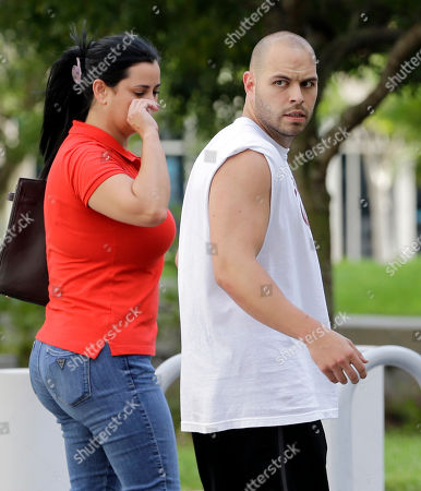 Stock Picture of Christopher Benjamin Engroba Christopher Benjamin Engroba, right, leaves the federal courthouse with an unidentified person, in Miami, . Engroba is among people charged with conspiracy to distribute testosterone