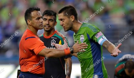 Stock Picture of Clint Dempsey Seattle Sounders' Clint Dempsey, right, makes a point with referee Hilario Grajeda, left, as Los Angeles Galaxy's A.J. DeLaGarza looks on during an MLS soccer match, in Seattle