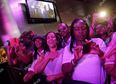 """Fans react as Tevin Campbell performs at the Essence Festival in New Orleans, . R&B singer Campbell, who thrilled fans as a teenager when he asked """"Can We Talk,"""" is performing for the first time at the Essence Festival as he seeks to re-ignite his career"""