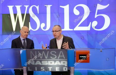 Gerard Baker, Robert Thomson Gerard Baker, left, Editor in Chief of The Wall Street Journal, listens as Robert Thomson, CEO of News Corp., speaks as they participate in the opening ceremonies at the Nasdaq MarketSite in New York, . News Corp opened the Nasdaq to celebrate the 125th anniversary of The Wall Street Journal