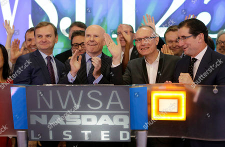 Stock Image of Gerard Baker, Robert Thomson Gerard Baker, Editor in Chief of The Wall Street Journal, second from left, and Robert Thomson, CEO of News Corp, second from right, participate in the opening ceremonies at the Nasdaq MarketSite in New York, . News Corp opened the Nasdaq to celebrate the 125th anniversary of The Wall Street Journal