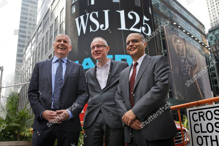 Stock Picture of Gerard Baker, Robert Thomson, Bedi Singh Gerard Baker, Editor in Chief of The Wall Street Journal, left, Robert Thomson, CEO of News Corp, center, and Bedi Singh, CFO of News Corp, participate in the opening ceremonies at the Nasdaq MarketSite in New York, . News Corp opened the Nasdaq to celebrate the 125th anniversary of The Wall Street Journal