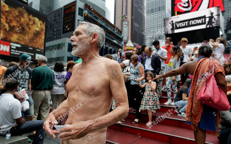 George Davis, a candidate for the San Francisco Board of Supervisors, makes a speech in the nude on Times Square, in New York. Davis spoke out against a 2013 San Francisco public nudity ban that was introduced by his opponent, Scott Wiener, saying nudity is a freedom of expression