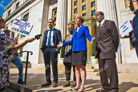 Stock Picture of Zephyr Teachout, Tim Wu Zephyr Teachout, third from right, campaigning for New York Governor, and running mate Tim Wu, third from left, stand with supporters Bertha Lewis, center, of the Black Leadership Action Coalition, and John Williams, second from right, clergy with the Seventh Day Adventist Network of Churches, during a press conference outside State Supreme Court, in New York. After failing in trial court last week, supporters of Gov. Andrew Cuomo continue their effort to knock Teachout off next month's primary ballot claiming she is not a resident