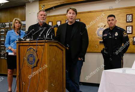 """Stock Image of John Langley, Morgan Langley, Todd Schmaderer, Jean Stothert Producers of the """"Cops"""" show John Langley, second left, and Morgan Langley, second right, answer questions with Omaha police chief Todd Schmaderer, right, and Omaha Mayor Jean Stothert, left, during a news conference at police headquarters in Omaha, Neb., . Bryce Dion, a sound technician with the """"Cops"""" television show who was embedded with Omaha police, was killed on Tuesday during an armed robbery at a Wendy's fast-food restaurant. The armed robber was shot and died as well"""