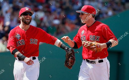 Dustin Pedroia, Stephen Drew Boston Red Sox's Dustin Pedroia, left, and Stephen Drew react after turning a double play on Baltimore Orioles' Nelson Cruz in the eighth inning of the first game of a baseball doubleheader in Boston