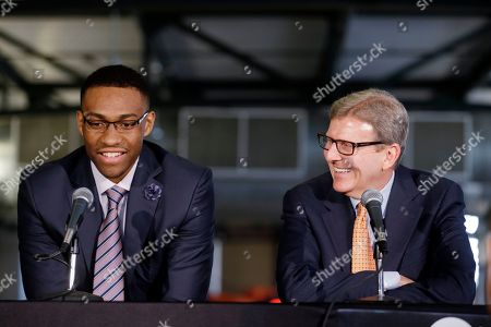 Jabari Parker, John Hammond Milwaukee Bucks general manager John Hammond watches as first round draft pick Jabari Parker speaks at a news conference, in Milwaukee