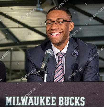 Jabari Parker, John Hammond, Larry Drew Milwaukee Bucks first round draft pick Jabari Parker is flanked by coach Larry Drew, left, and general manager John Hammond as he is introduced at a news conference, in Milwaukee