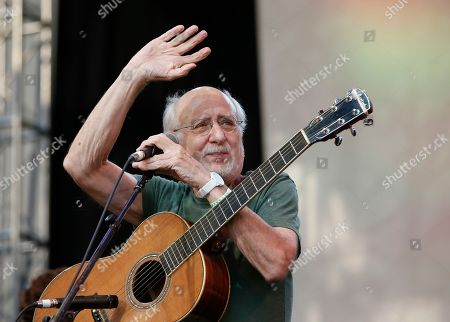 "Peter Yarrow Singer-songwriter Peter Yarrow of the 1960's era musical trio ""Peter Paul and Mary"" waves the crowd during a memorial tribute concert for folk icon and civil rights activist Pete Seeger at Lincoln Center's Damrosch Park in New York, . Seeger died at age 94 in January"