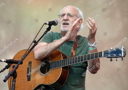 "Peter Yarrow Singer-songwriter Peter Yarrow of the 1960's era musical trio ""Peter Paul and Mary"" claps and encourages the audience to sing along during a memorial tribute concert for folk icon and civil rights activist Pete Seeger at Lincoln Center's Damrosch Park in New York, . Seeger died at age 94 in January"