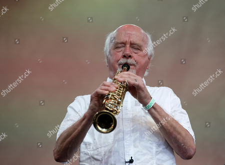 Psul Winter Musician Paul Winter plays his horn during a memorial tribute concert for folk icon and civil rights activist Pete Seeger at Lincoln Center's Damrosch Park in New York, . Seeger died at age 94 in January