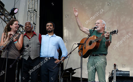 "Peter Yarrow Singer-songerwriter Peter Yarrow, right, of the 1960's era musical trio ""Peter Paul and Mary"" sings during a memorial tribute concert for folk icon and civil rights activist Pete Seeger at Lincoln Center's Damrosch Park in New York, . Seeger died at age 94 in January"