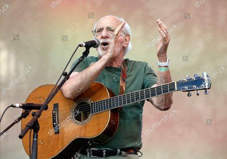 "Peter Yarrow Singer-songwriter Peter Yarrow of the musical trio ""Peter, Paul and Mary"" claps and encourages the audience to sing along during a memorial tribute concert for folk icon and civil rights activist Pete Seeger at Lincoln Center's Damrosch Park in New York, . Seeger died at age 94 in January"
