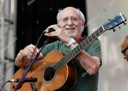 Stock Photo of Peter Yarrow Singer-songwriter Peter Yarrow of Peter Paul and Mary laughs as he takes the microphone after no one introduced him during a memorial tribute concert for folk icon and civil rights activist Pete Seeger at Lincoln Center's Damrosch Park in New York, . Seeger died at age 94 in January