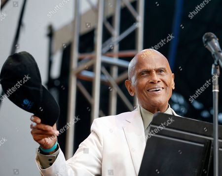 Harry Belfonte Singer and activist Harry Belafonte tips his cap to the crowd before speaking during a memorial tribute concert for folk icon and civil rights activist Pete Seeger at Lincoln Center's Damrosch Park in New York, . Seeger died at age 94 in January