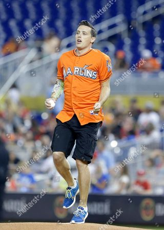 Stock Picture of Jeff Sutphen Jeff Sutphen of Nickelodeon, prepares to throw out a ceremonial first pitch before the start of a baseball game between the Miami Marlins and the Philadelphia Phillies, in Miami