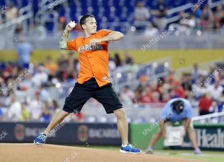 Stock Image of Jeff Sutphen Jeff Sutphen of Nickelodeon, throws out a ceremonial first pitch before the start of a baseball game between the Miami Marlins and the Philadelphia Phillies, in Miami