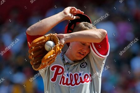 David Buchanan Philadelphia Phillies starting pitcher David Buchanan wipes his head after giving up a two-run home run to Pittsburgh Pirates' Andrew McCutchen during the first inning of a baseball game in Pittsburgh
