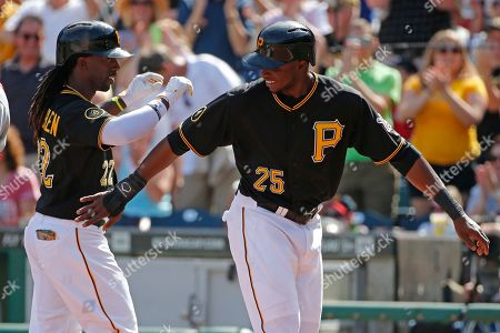 Andrew McCutchen, Gregory Polanco Pittsburgh Pirates' Andrew McCutchen, left, celebrates his two-run home run off Philadelphia Phillies starting pitcher David Buchanan with teammate Gregory Polanco (25) during the first inning of a baseball game in Pittsburgh