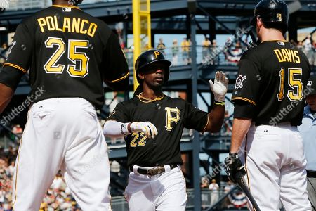 Andrew McCutchen Pittsburgh Pirates' Andrew McCutchen (22) celebrates with teammates Ike Davis (15) and Gregory Polanco (25) after hitting a two-run home run off Philadelphia Phillies starting pitcher David Buchanan during the first inning of a baseball game in Pittsburgh . The Pirates won 3-2. At left is Phillies catcher Cameron Rupp