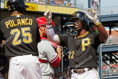 Stock Picture of Andrew McCutchen, Gregory Polanco Pittsburgh Pirates' Andrew McCutchen (22) celebrates his two-run home run off Philadelphia Phillies starting pitcher David Buchanan with teammate Gregory Polanco (25) during the first inning of a baseball game in Pittsburgh