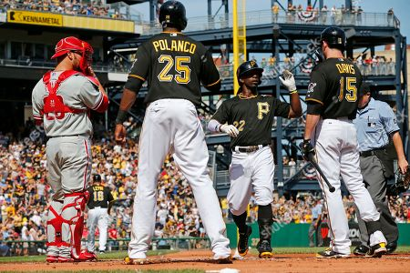 Stock Photo of Andrew McCutchen Pittsburgh Pirates' Andrew McCutchen (22) celebrates with teammates Ike Davis (15) and Gregory Polanco (25) after hitting a two-run home run off Philadelphia Phillies starting pitcher David Buchanan during the first inning of a baseball game in Pittsburgh . The Pirates won 3-2. At left is Phillies catcher Cameron Rupp