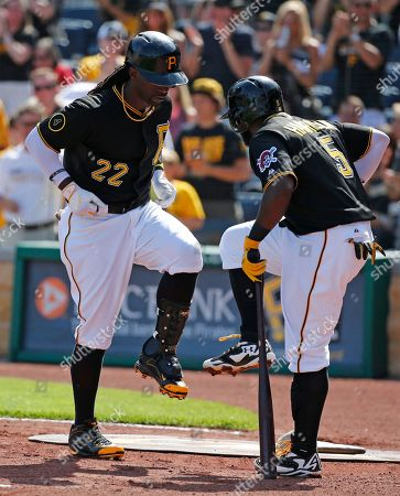 Andrew McCutchen, Josh Harrison Pittsburgh Pirates' Andrew McCutchen (22) celebrates his two-run home run off Philadelphia Phillies starting pitcher David Buchanan as he returns to the dugout with teammate Josh Harrison (5) during the first inning of a baseball game in Pittsburgh